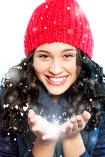 Christmas girl with snow in hands